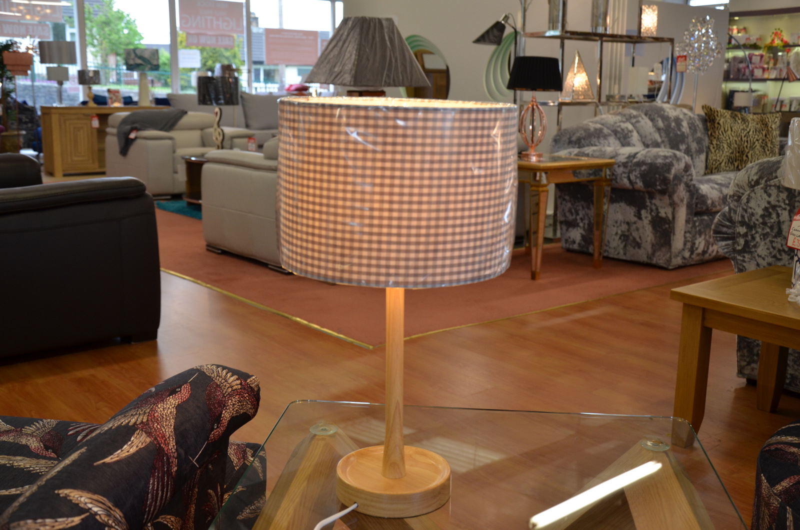 solid oak Oakton floor and table lamps now half price at our lighting showroom in Clitheroe Lancashire