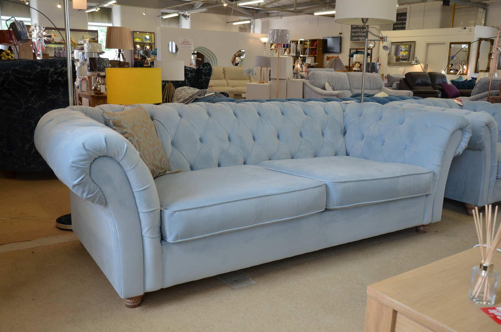 A photo of a pale blue velvet Maddox Chesterfield sofa and matching armchair